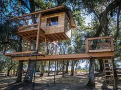 """Feider built this treehouse   to  match the owner's home. It's designed, he says, for maximum tree and  star gazing. The enclosed clubhouse serves as a look-out tower. """"The  structure is built of steel brackets, kiln-dried Douglas fir, cedar  siding and galvanized, corrugated roofing,"""" he explains. It features a  trap door, 3 levels, 2 netted """"hang-out"""" areas, a bucket lift, two  swings and a slide (some features not shown)."""
