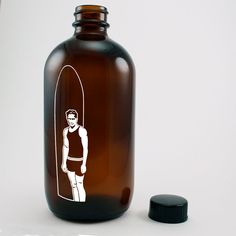 Cold Brew Coffee bottle in brown, with a surfing themed graphic. Designed by Caspar Atherton www.cargocollective.com/casparatherton