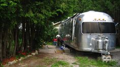 This couple live in an airstream trailer to save money and pursue their dreams. Read their story!
