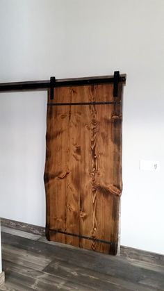 In a few months we'll be coming out with our new line of wood slab sliding barn doors. Let us know what you think.