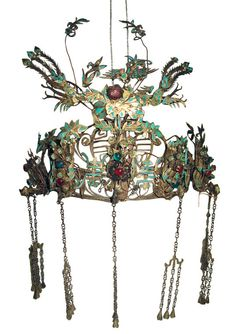 China | Kingfisher tiara/headdress used by a provencial Chinese leader dating to the 19th century. Rendered in hand wrought brass and metal, inlaid with iridescent turquoise kingfisher feathers. Cabochon glass jewels present as well. | Price on Request
