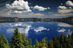 Crater Lake was formed when Mount Mazama – a dormant volcano — erupted in about 5700 B.C. Eventually rain and snow accumulated to form the deepest lake in the United States. On a clear summer day, the water in Crater Lake is such a deep blue that many have said it looks like ink.