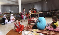 This photo shows Yazidis refugees resting. Most of them are women and children.