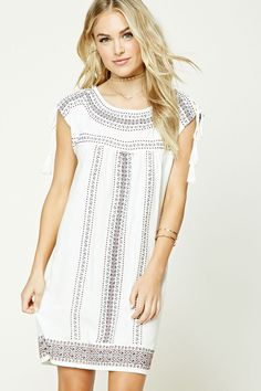 Forever 21 Contemporary - A woven shift dress featuring allover ornate embroidery, cap sleeves, a round neckline, and lace-up shoulders with tasseled ends.