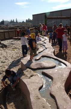 unique play river (wouldn't it be fun to connect something like this to the gutter system of our school building!)