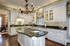 Traditional Kitchen with Custom hood, High ceiling, Inset cabinets, Chandelier, L-shaped, Raised panel, Mullion Pattern #1