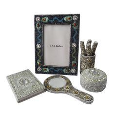 """Designer Gift Lot Set Pen Pot, Mirror, Photo Frame, Jewelry Box Decorative Beaded Mdf Lac Material Table Topper Silver Set of 5 Pcs Christmas Gift. Beautiful Handmade gift lot which include Diary, Hand Mirror, Jewelry Box, Pen Pot and Photo Frame This ethnic gift lot combine traditional with a modern design, a great accessory for traditional touch. Material, Size and Color- Diary : Material-Satin Silk and Lac, Size-Length-5"""" x Width-3"""", Color-Silver Jewelry Box : Material-Aluminum and Lac..."""