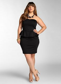Web Exclusive: Strapless Peplum Dress     $39.50  Style: ASI3023X  Plus size dress features a strapless silhouette that is accented by a sweetheart neckline, ruffle overlay at waist and is finished with a center slit at back. Lined.  Machine wash cold  Made in the U.S.A  95% rayon, 5% spandex  Web Exclusive items must be returned to our online store