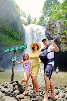The gigantic Tegenungan Waterfall near Ubud in Bali, Indonesia!  Click the photo to read about 10 things you should do with kids in Ubud!!