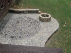 Paver patio with firepit and circular inset