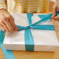 Learn the art of gift wrapping from the experts at Hallmark. Watch this fun video to learn how to tie a simple bow with ribbon. #Hallmark #HallmarkIdeas