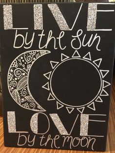 "DIY Canvas ""Live by the Sun Love by the moon"" Items you will need: Silver paint pen/marker Canvas Black paint - acrylic Paint brush Glitter Ruler Pencil Glue 1. Paint the canvas black wait to dry and put on a second coat of black paint. 2. When dry grab your ruler and pencil and draw a sketch that you can go over top of with the paint marker/pen. TIP: Make sure you measure to keep the letter sizes consistent on the top and the bottom of the canvas. 3. Draw over your sketch wi..."