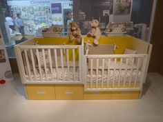 Compact and stylish cribs for twins.