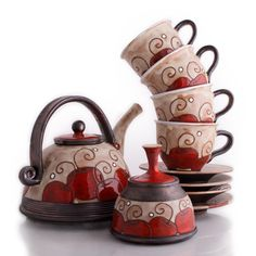 """FREE SHIPPING on the set. Details and Dimensions 4 Cherry Tea cups : W 4"""" x H 3"""" ; saucer diam. 5.5"""" Cherry Teapot : W 7"""" x H 5"""" - Cherry Sugar bowl : W 4.5"""" x H 4"""" - Wheel- thrown stoneware clay body"""