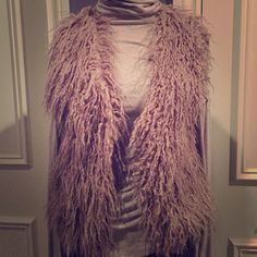 Faux fur vest Vest has a sweater back. It's a med but fits more like a small. Only worn a few times. Ya Jackets & Coats Vests
