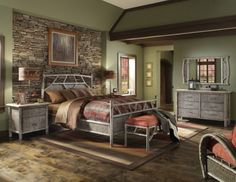 love the rustic look of the stone wall headboard. Room in the cabin