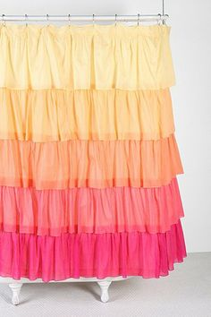 Ombre Ruffle Shower Curtain - Urban Outfitters- one Of three choices for the girls bathroom at the new house. Paired with a deep melon/orangish color for the walls.
