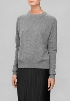 Crafted from soft, comfortable cashmere, this sweater has a clean design with asymmetrical rib-knitting along the bottom hem.