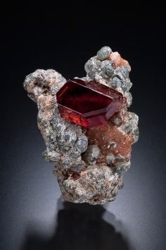 Grossular garnet var. hessonite with clinochlore crystals on a matrix.