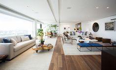 Varanda integrada à sala, combinação das cores e objetos para um ambiente neutro e lindo