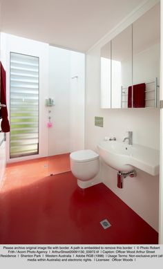 Dalsouple natural rubber floor tiles in a Pantone® red in a bathroom in Perth, Australia. Photo: Officer Woods Architects.
