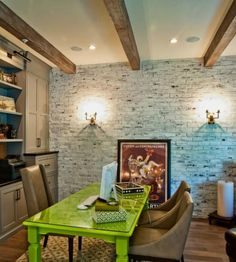 Green table servingg as desk - a pop of color in the otherwise neutral home office
