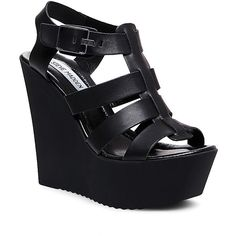 Steve Madden Women's Bessa Platform Wedges ($40) ❤ liked on Polyvore featuring shoes, sandals, heels, wedges, black leather, black wedge sandals, black leather sandals, summer sandals, summer wedge sandals and black platform sandals