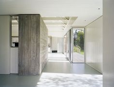 The contrast between the raw wood wall, white walls and the windows is so nice.