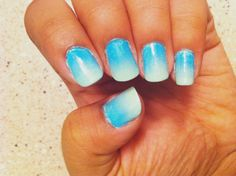 Ombre effect - apply a base coat, dab a sponge painted with desired colors onto nails, and use a top coat to even it all out