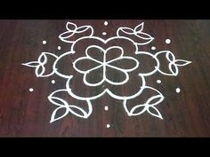Simple 9 dots Rangoli With Deepam Rangoli Designs Simple Diwali, Rangoli Simple, Indian Rangoli Designs, Rangoli Designs Latest, Rangoli Designs Flower, Free Hand Rangoli Design, Rangoli Border Designs, Small Rangoli Design, Rangoli Designs With Dots