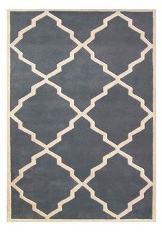 Love the muted blue in this rug. Awesome shapes too.