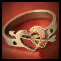 Valentine's day gift! heart cupid arrow ring sz 7 LAST ONE!!!!!!   Stainless steel and silver plated ring size 7, double heart design with a small quipids arrow going through them. New in package NEVER worn just put on once for the second pic. Super cute ring! Jewelry Rings