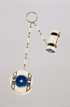 Compact and Lipstick Case, ca. 1920 Cartier, New York  Gold, enamel, lapis lazuli, diamonds This Cartier piece serves both practical and decorative purposes. The lipstick case and compact are both enameled in black and white with lapis lazuli and diamond accents.