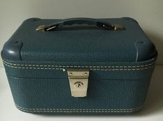 Check out this item in my Etsy shop https://www.etsy.com/listing/481771131/vintage-luggage-train-case-travel-carry