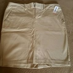 KHAKI MIN SKIRT This skirt has pockets front and back. With a back pleat split and stretch it is a nice fit. Perfect for boots and winter stockings.  NWT Old Navy Skirts Mini