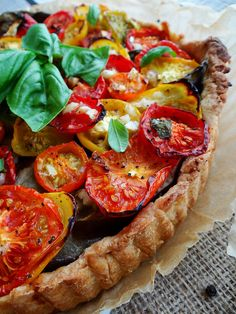 tomato tart: eggplant, heirloom tomatoes and basil along with a hearty dose of freshly cracked pepper make a satisfying and hearty tart with the taste of summer and the comforts of fall.