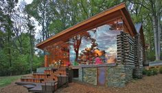 renovated and restored 100-year-old log cabin on the bank of the potomac river in maryland. by hopkins & porter architects.