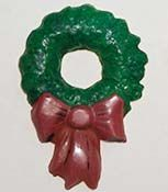 Christmas wreath ornament is cast in a common candy mold with Durham's Water Putty and then painted. A magnet or wire hanger (such as a paper clip) can be inserted into the back of the casting before it hardens. #Durham's #Durhams #WaterPutty #ChristmasOrnament #ChristmasDecoration #RefrigeratorMagnet