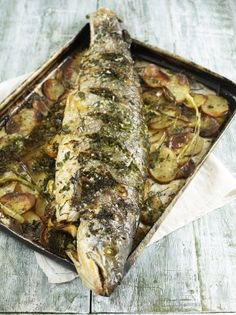 This whole roasted salmon recipe by Jamie Oliver is just perfect for dinner parties. Stuffed with lemon and fresh herbs, it's guaranteed to wow your guests. Whole Salmon Recipe, Salmon Fish Recipe, Whole Fish Recipes, Salmon Recipes, Tilapia Recipes, Fish Dishes, Seafood Dishes, Seafood Recipes, Roasted Salmon