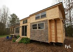 Here is our knock out of a tiny house. The exterior embodies a rustic charm with its combination of light wood and stone-colored bricks. #tinyhouseexteriorcolors