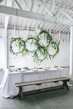 Hanging floral installations lend themselves beautifully to family-style gatherings. Not only do they make for memorable decor, they also free up table space for more food! The showstopper here looks