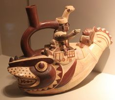 Moche (Mochica) Culture: Stirrup spout bottle representing sacrifice of defeated warriors, Apogee Epoch (1 AD - 800 AD), via Flickr