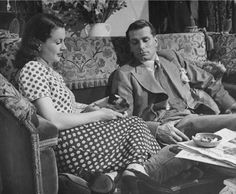 """Imagine if Mad Men were made in Britain, Vivien Leigh looks like the perfect """"Betty."""" Laurence Olivier the perfect """"Don Draper."""" In this domestic scene from their (real) marriage, so handsome Laurence (Don) looks like he is tolerating the scene and will shortly make up an excuse about getting back to the office. Note the full ashtray. Probably a martini off to the side!!"""