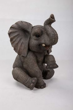 Sitting elephant baby statue is an adorable life like replica gigantic animal baby. Made with polyresin this statue is good for both indoors and outdoors. Makes an adorable gift for the loved ones. Elephant Trunk Up, Elephant Home Decor, Elephant Art, Elephant Tattoos, Elephant Gifts, Ceramic Elephant, Ceramic Animals, Baby Elefant, Elephant Jewelry