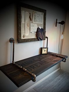 Unique and industrial, this beauty has been created to serve not only your functional needs, but your aesthetic needs as well. This wall-mounted wood desk features a dark semi-transparent ebony stain to show the beautiful natural wood grain and texture. Then anchored to the wall with heavy black iron iron pipe brackets. Painted on top to inspire you: WORK HARD. DREAM BIG.  This desk is not only sturdy, it has a one-of-a-kind design. Our floating wall desk is not your average, puny floating…