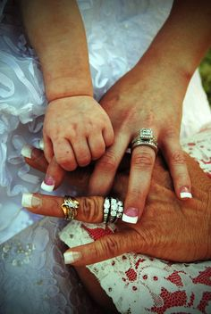 Valerie Brooker Photography -hands of the bride with her mother and daughter also with 3 generation wedding bands (grandma, mother and bride)