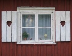 Swedish windows with heart shutters