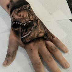 What does t-rex tattoo mean? We have t-rex tattoo ideas, designs, symbolism and we explain the meaning behind the tattoo. Skull Hand Tattoo, Hand Tats, Small Tattoos, Cool Tattoos, T Rex Tattoo, Jurassic Park Tattoo, Dinosaur Tattoos, World Tattoo, Leg Sleeves