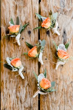 orange boutonnieres - photo by Caroline Lima Photography http://ruffledblog.com/blue-and-peach-organic-wedding