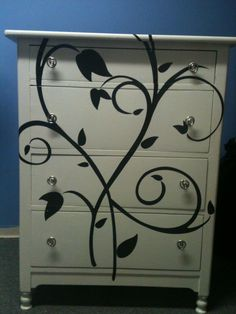 re-finished dresser with wall decal and clear inishing spray.